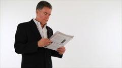 Businessman reading bad news in newspaper Stock Footage