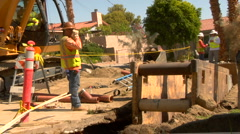 Construction worker puts on sunglasses Stock Footage