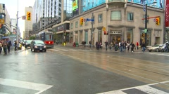 People traffic and streetcars in Toronto, wide shot Stock Footage