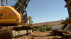 Excavator moves heavy object Stock Footage