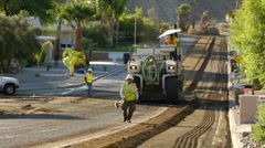 Grinding asphalt machine rips up road Stock Footage