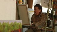 Older Woman Painting Stock Footage