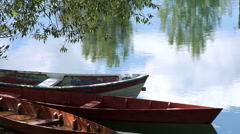 Boats anchored on the river coast Stock Footage