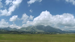 Clouds over mountain pastures - stock footage