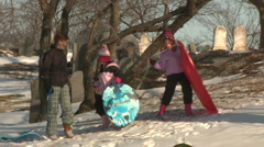 Kids Run Up Hill WIth Sleds  Stock Footage