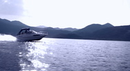 Stock Video Footage of Speedboat on lake