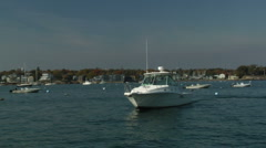 Pan of fishing boat in Marblehead Harbor Stock Footage