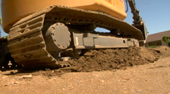 Excavator digging up road Stock Footage