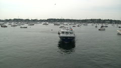 Lobster boat cruising in to dock Stock Footage
