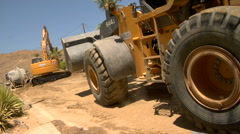 Bulldozer drives past Stock Footage