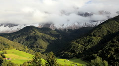Cloudscape Mountains and Alpine pastures, Seiser Aim, Dolomites, Italy Stock Footage