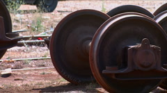 Old wheels of the train goes to landfill Stock Footage