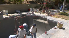 Group of workers remodel swimming pool Stock Footage