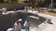 Stock Video Footage of Group of workers remodel swimming pool
