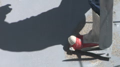 Shadow of worker in special shoes Stock Footage