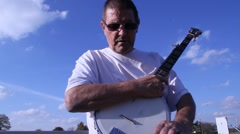 tuning a five string banjo - stock footage