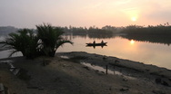 Fisherman into sunset Stock Footage