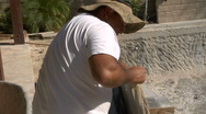 Stock Video Footage of Stonemason draws line on stone before cutting