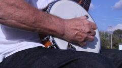 Banjo player leaving - stock footage