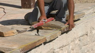 Stock Video Footage of Stonemason leveling new pool coping CU