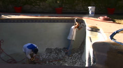 Construction workers demolish old pool tile with jackhammer Stock Footage