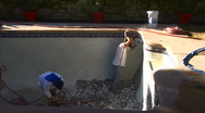 Stock Video Footage of Construction workers demolish old pool tile with jackhammer