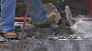 Stock Video Footage of Construction worker demolishes pool with jackhammer CU
