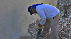 Construction worker demolishes pool with jackhammer Stock Footage