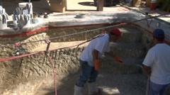 Construction worker applying Gunite Shotcrete to swimming Pool Stock Footage