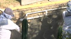 Man sprays gunite on new spa Stock Footage