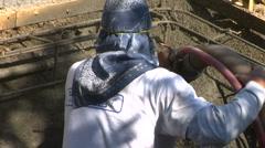 Construction worker applying Gunite Shotcrete to spa CU - stock footage