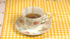 Pouring hot tea in cup Stock Footage