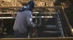 Construction worker applying Gunite Shotcrete to spa :30 - stock footage