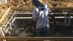 Construction worker applying Gunite Shotcrete to spa :PT 3 - stock footage