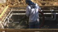 Stock Video Footage of Construction worker applying Gunite Shotcrete to spa :PT 3