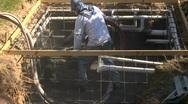 Stock Video Footage of Construction worker applying Gunite Shotcrete Wide