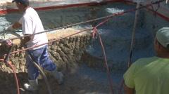 Construction worker applying Gunite Shotcrete - stock footage