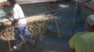 Stock Video Footage of Construction worker applying Gunite Shotcrete