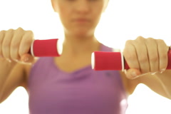 Woman working out with dumbbells, isolated on white - stock footage