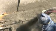 Stock Video Footage of Construction worker applying Gunite Shotcrete CU