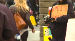 People walking by anonymous homeless man, #2 Stock Footage