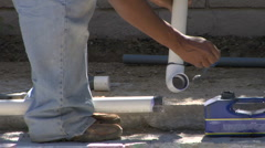 Man glues PVC pipes :30 Stock Footage
