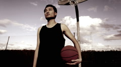 Potrait of Chinese male with basketball Stock Footage