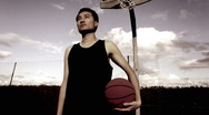 Stock Video Footage of Potrait of Chinese male with basketball