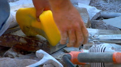 Cutting stone sponge hammer Stock Footage