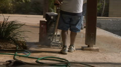 Construction worker grinds cement Med 1 Stock Footage