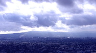 Stock Video Footage of Moving Storm Clouds Over Urban Landscape 2