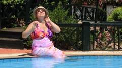 Woman by pool - stock footage