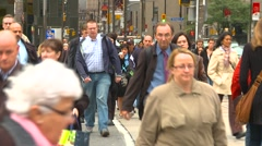 People, crowds crossing street, downtown Toronto Stock Footage