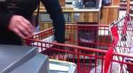 Stock Video Footage of Checkout Clerk